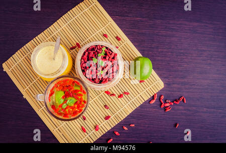 Cup of delicious dietary Goji berry tea with lime and honey on wooden background with measuring tape. Wolfberry for a healthy diet. Alternative medici - Stock Photo