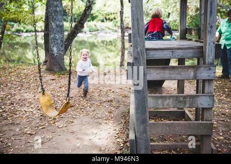 Children in forest playground - Stock Photo