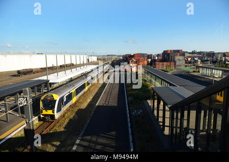 The Auckland Transport electric train connects the suburbs with the city center. - Stock Photo