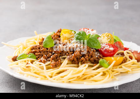 Spaghetti Bolognaise topped with minced beef - Stock Photo