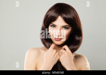 Hair Care Concept. Healthy Woman with Long Shiny Hairstyle. Beautiful Smiling Lady with Brown Hair for Beauty Salon Background - Stock Photo