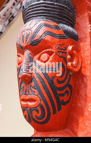 new zealand rotorua new zealand whakarewarewa maori carving facial tattoos maori tattoo face the meeting house wahiao new zealand north island nz - Stock Photo