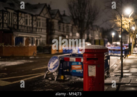 A view of a post box on a suburban street. From a series of pictures of the streets of Ealing during a cold snap in London. Photo date: Monday, March  - Stock Photo
