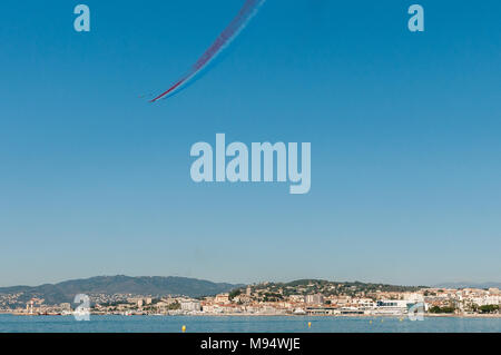 Cannes, France - 22 march 2018 : flying over the bay of Cannes, by the patrol of France and the Red Bull Air Race plane, as part of the preparation of the Red Bull Air Race of Cannes 'DIDES Frederic Alamy live news' - Stock Photo