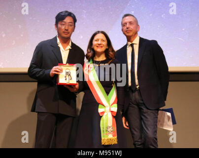 23rd Mar, 2018. S. Korean actor awarded Florence cultural honor South Korean actor Ha Jung-soo (L) poses with officials in Florence, Italy, on March 22, 2018, after receiving the city's culture and arts award. With the award, Ha became an honorary citizen of Florence. Film director Park Chan-wook was the first South Korean to win the award last year. At center is Deputy Mayor of Florence Cristina Giachi. At right is Riccardo Gelli, head of the Florence Korea Film Fest organizing committee. Credit: Yonhap/Newcom/Alamy Live News