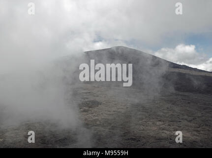 Ascending clouds at the summit of the Piton de la Fournaise - Stock Photo