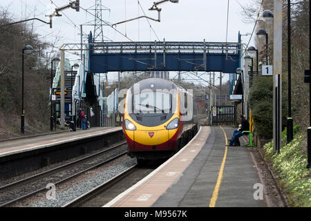Virgin Trains Pendolino electric train passing through Canley station, Coventry, West Midlands, UK - Stock Photo