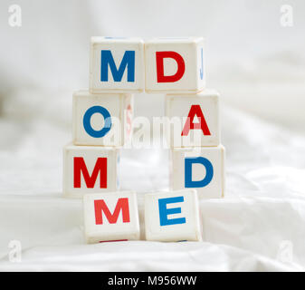 qubes  spelling mom dad and me - Stock Photo