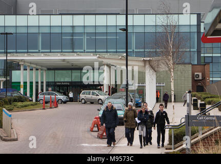 The main entrance of the Royal Stoke Hospital in Stoke on Trent with visitors walking on the pavement - Stock Photo