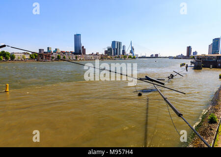 ROTTERDAM, NETHERLANDS - MAY 25, 2017: Exterior view of the promenade at the Boompjeskade Street with a view to the Nieuwe Maas River on May 25, 2017. - Stock Photo