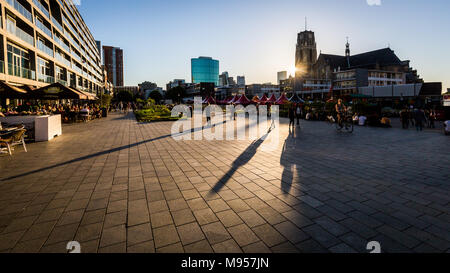 ROTTERDAM, NETHERLANDS - MAY 25, 2017: Exterior view of the Market Hall and a woman in front of it on May 25, 2017. The building was opened on October - Stock Photo