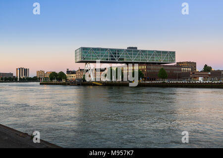 ROTTERDAM, NETHERLANDS - MAY 25, 2017: Exterior view of the promenade from the Prins Hendrikkade Street at evening with a view to the Maas River on Ma - Stock Photo