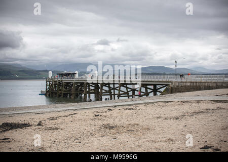 People on Beumaris pier during fair weather.Beumaris,Anglesey,United Kingdom,21 April,2017. - Stock Photo