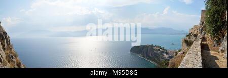 Panoramic view of Argolic Gulf, Acronauplia, the oldest part of the city of Nafplion, Bourtzi and part of Palamidi fortess - Stock Photo