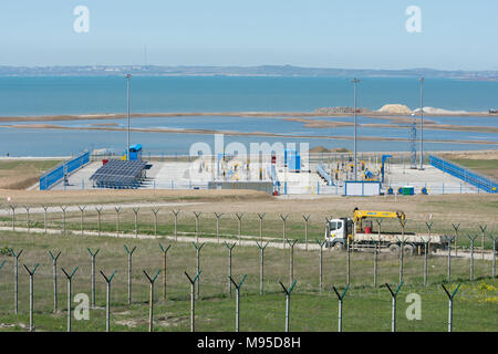 Taman, Russia - 15 April 2017: A platform with communications in front of the bridge that is being built across the Kerch Strait, from the tamani side - Stock Photo