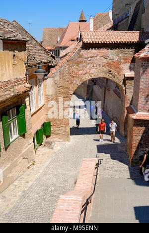Sibiu, Transylvania, Romania. Street and brick arch in the Lower Town. Pasajul Scarilor / Passage of the Stairs - Stock Photo