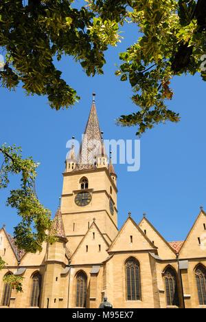 Sibiu, Transylvania, Romania. Lutheran Cathedral of Saint Mary / Evangelical Church (1300-1520; Gothic) in Piata Huet (square) 73.34 m high steeple - Stock Photo