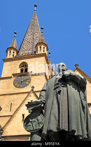 Sibiu, Transylvania, Romania. Lutheran Cathedral of Saint Mary / Evangelical Church (1300-1520; Gothic) in Piata Huet (square) Monument to Georg Danie - Stock Photo