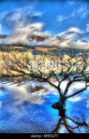 Loch Lomond, Scotland. Artistic view of Loch Lomond with a snow covered Ben Lomond in the background. - Stock Photo