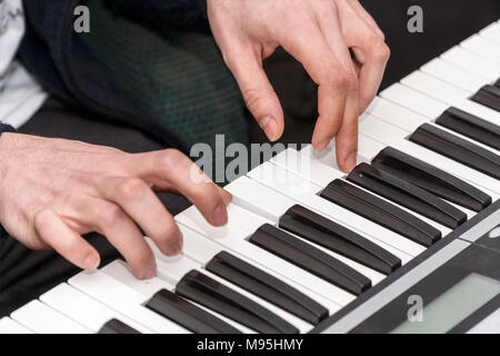 Hands of a pianist. Plays on the synthesizer - Stock Photo