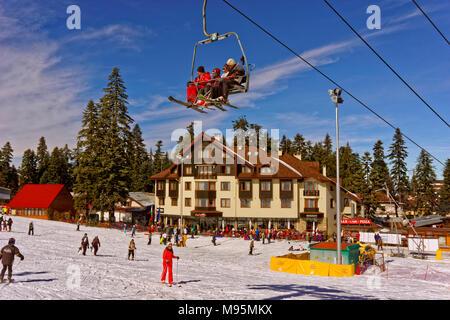 Hotel Ice Angels and Martinovi Baraki chairlift at Borovets Ski resort, Targovishte, Bulgaria. - Stock Photo