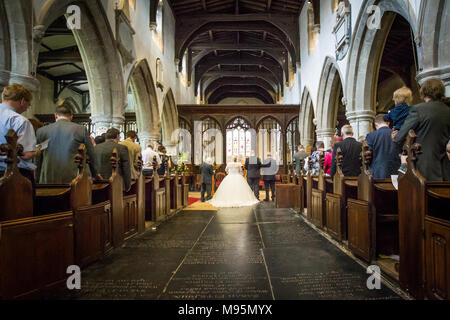 Bride and groom getting married in church - Stock Photo