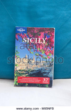 Poznan, Poland - March 18, 2018: Lonely Planet travel book about Sicily in Italy - Stock Photo