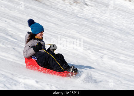 A ten year old girl sledging in Quebec Canada - Stock Photo