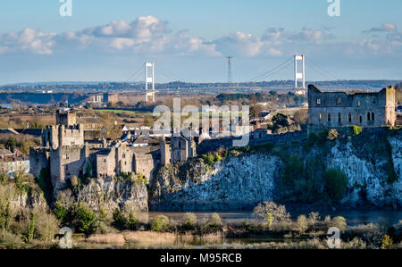 View from Alcove Wood on the River Wye over Chepstow Castle and the distant Severn Bridge - South Wales UK - Stock Photo