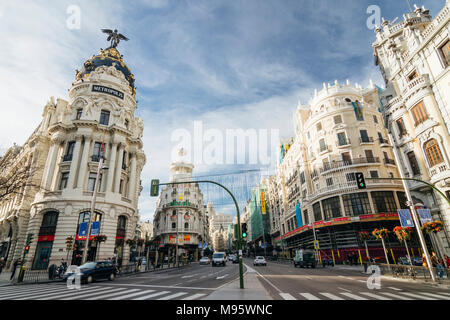 Madrid, Spain : Gran Via main thoroughfare and Metropolis Building. Inaugurated in 1911, it was designed by Jules and Raymond Février - Stock Photo