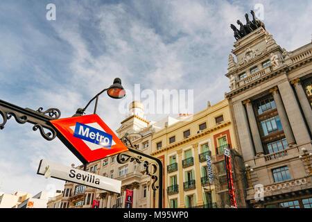 Madrid, Spain : Sevilla metro sign by BBVA bank building in Alcala street. - Stock Photo