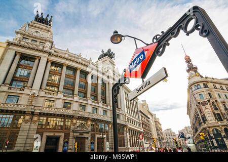 Madrid, Spain : Madrid, Spain : Sevilla metro sign by BBVA bank building (1920 - 1923) in Alcala street. - Stock Photo