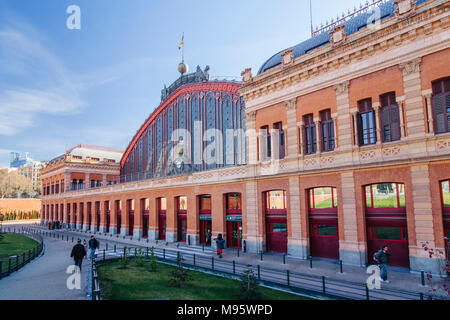 Madrid, Spain : Front view of Atocha train Station at Plaza del Emperador Carlos V (Emperor Charles V Square) inaugurated on 9 February 1851. - Stock Photo