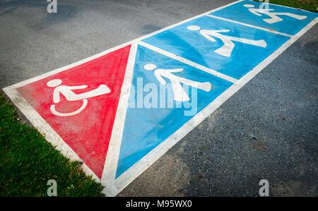 Traffic sign paint on asphalt road for wheelchair or pedestrian walk - Stock Photo