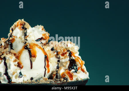Piece of chocolate almond cornmeal cake with balsamic drizzle and ice cream - Stock Photo