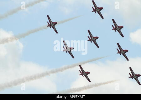 Canadian Forces 431 Air Demonstration Squadron also know as the snowbirds performing at the Hamilton Air Show - Stock Photo