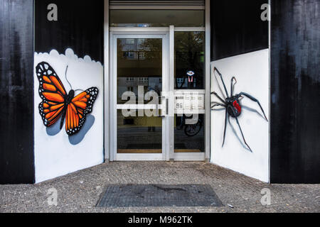 Berlin,Schöneberg, Colourful street art insects.URBAN NATION artproject encourages street artists to decorate buildings in Bülowstrasse - Stock Photo