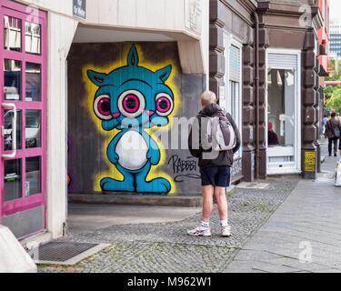 Berlin,Schöneberg,Building entrance & street art by Rabbit. URBAN NATION art project encourages street artists to decorate buildings in Bülowstrasse - Stock Photo
