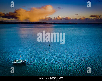 An aerial view of a solitary boat on the River Exe near Starcross in Devon, UK - Stock Photo