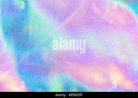 Holographic real texture in blue pink green colors with scratches and irregularities. Holographic color wrinkled foil. Holographic rainbow foil. - Stock Photo