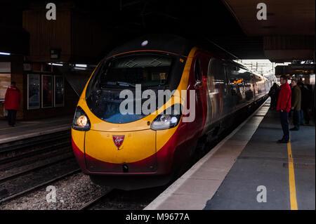 Class 390 Virgin Pendolino train approaches Birmingham International Railway Station  with a service to London Euston, UK. - Stock Photo