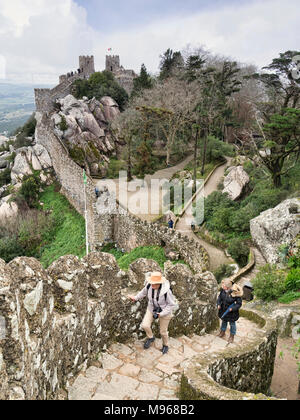 3 March 2018: Sintra, Portugal - Tourists explore the Castle of the Moors at Sintra, Portugal, on an early spring day. - Stock Photo