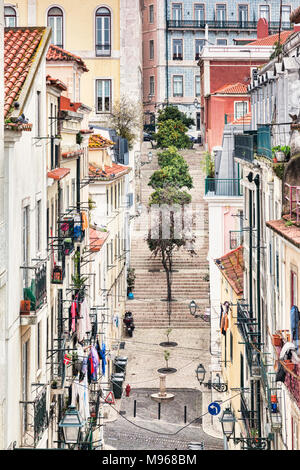 A back street in Lisbon, Travessa da Laran Jeira, with tyoical homes and steps. - Stock Photo