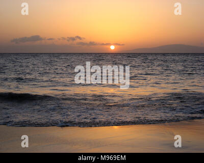 Sunset in Maui over the Pacific Ocean - Stock Photo