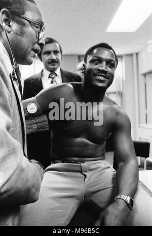 Super Fight II was a non-title boxing match between Muhammad Ali and Joe Frazier. The second of the three Ali vs Frazier bouts, it took place at Madison Square Garden in New York City on January 28, 1974. Ali was a slight favourite to win, and did by a unanimous decision. (Picture) Joe Frazier having a pre-fight medical for 'Super Fight II.' - Stock Photo