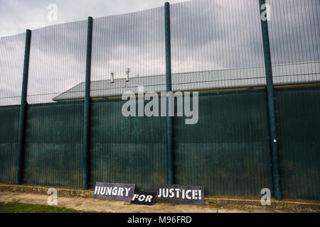 Milton Ernest, UK. 13th May, 2017. Signs used by campaigners against immigration detention protesting outside Yarl's Wood Immigration Removal Centre. - Stock Photo