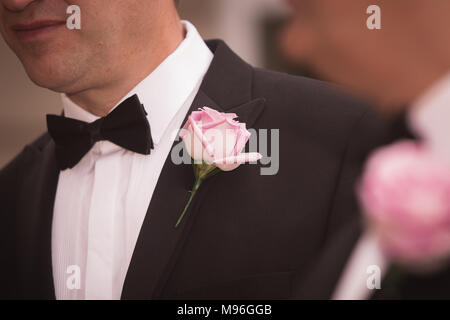 flower in lapel at wedding - Stock Photo