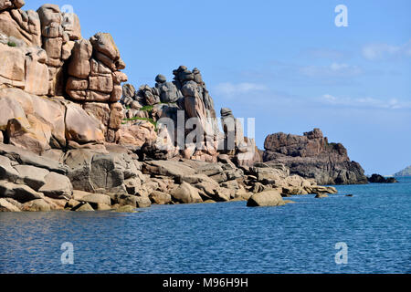Famous Pink Granite Coast (côte de granite rose in french) with stones in equilibrium at Ploumanac'h, village in the commune of Perros-Guirec France - Stock Photo