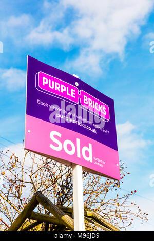 purple bricks purplebricks sold board, purple bricks estate agent, purple bricks estate agents sign, purple bricks sale board UK, purple bricks UK - Stock Photo