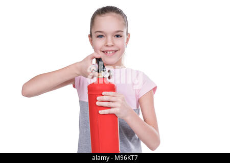 Young girl holding a fire extinguisher in her hands and ready to use it isolated on a white background - Stock Photo